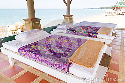 Vectores del masaje en la playa
