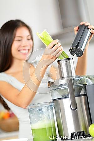Free Vegetable Juice - Woman Juicing Green Vegetables Stock Photos - 38623863