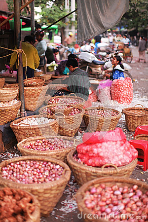 Vegetable market with bacskets of onions in Yangon Editorial Image