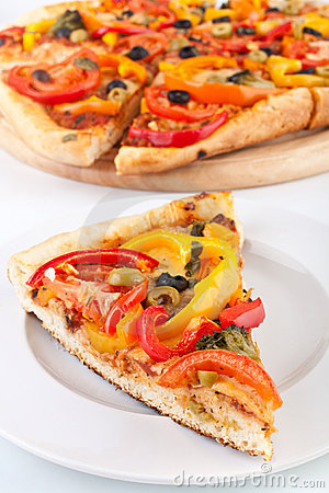 Vegetable pizza slice, pizza at the back