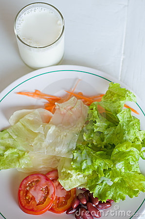 Vegetable Salad in White plate with Milk