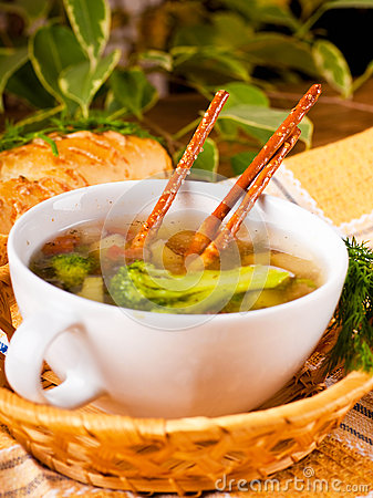 Vegetable soup with salty straws