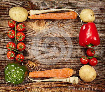 Vegetables frame on wooden board
