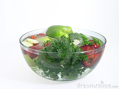 Vegetables and fruits in a clear bowl; 1 of 5