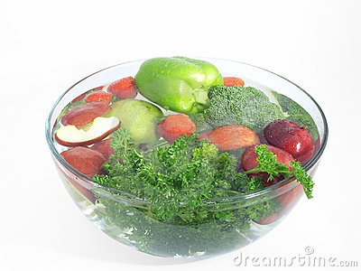 Vegetables and fruits in a clear bowl; 2 of 5
