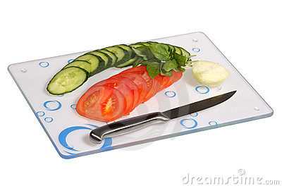 Vegetables on a glass cutting board