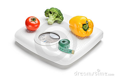 Vegetables and measuring tape on a weight scale