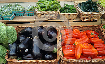 Eggplant, peppers for sale at farmers market