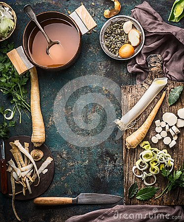 Free Vegetables Soup Cooking Preparation With Parsnip And Leek On Rustic Kitchen Table Background With Ingredients, Pot , Vegetable Bro Royalty Free Stock Photos - 101843678