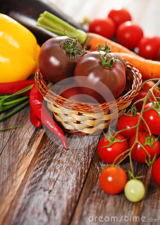 Vegetables still life in wooden background