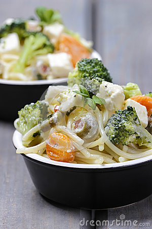 Vegetarian pasta with broccoli, ricotta, basil, carrot and olive