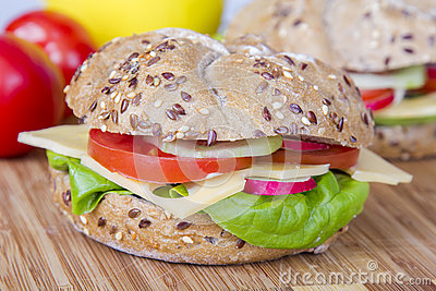 ... sandwich roll with lettuce, cheese, tomato, radish and cucumber