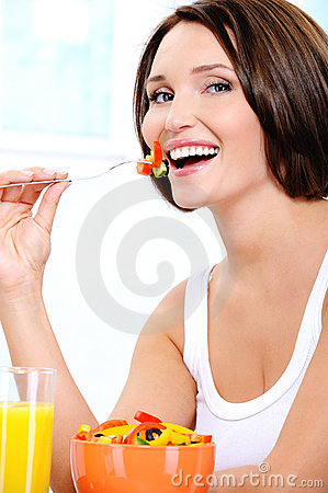 Vegetarian woman  eats useful vegetable food