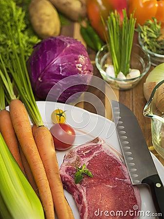 Vegitables and steak on a cutting board