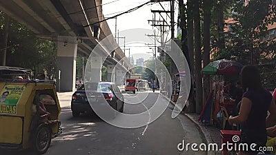 Vehicles run on street in Quezon, Philippines. Vehicles run on street in Quezon, Metro Manila, Philippines stock footage