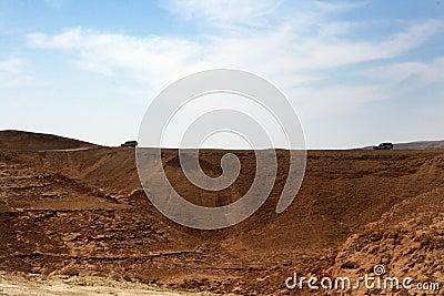 Vehicles travelling in desert