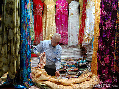 Vendor selling dresses in the Moroccan souks Editorial Photography