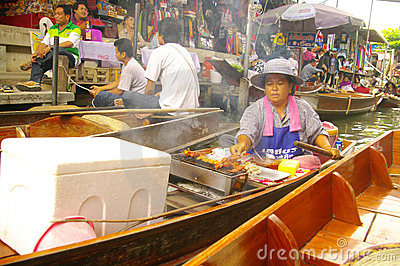 Vendor woman at the floating market Editorial Image
