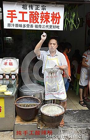 Vendors peddle Editorial Photo