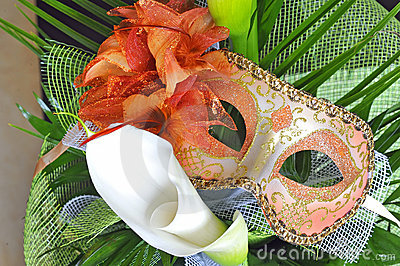 Venetian mask and flowers