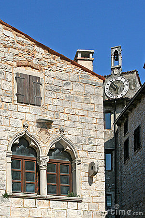 Venetian windows on the old palace with the clock