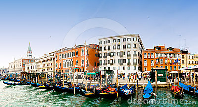Venezia, Italy - Gondolas and San Marco bell tower Editorial Image