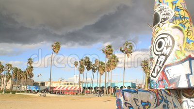 Venice Beach artwork as storm moves in timelapse stock footage