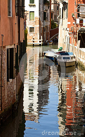 Venice, canal and water reflection