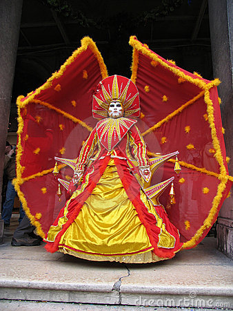 Venice Carnival: mask in red and yellow