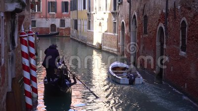 Venice, gondola floats on a narrow channel. powerboat stock footage
