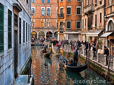 Venice view with gondolas and masks Editorial Photo