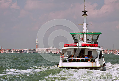 Venice-Waterbus full of tourists to S.Marco square Editorial Stock Image