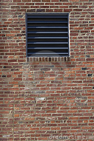 Vent in a brick wall