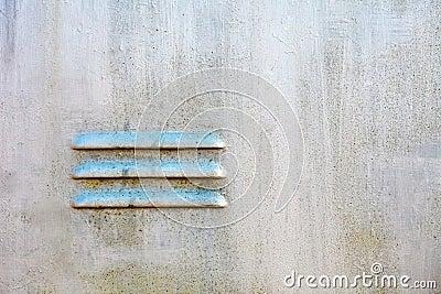 Ventilating lattice on old metal surface