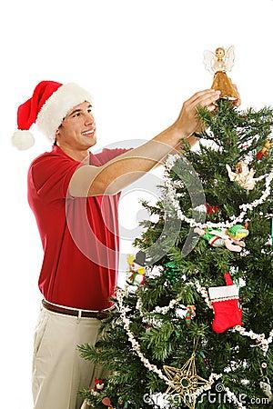 Verfraaiend Kerstboom die - Engel plaatst