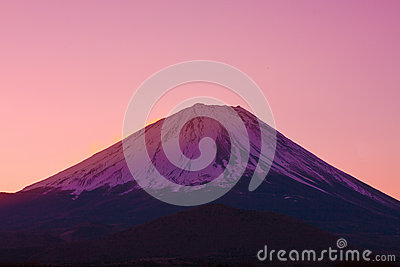 Vermilion sky and the summit of Mount Fuji, a world heritage in Japan