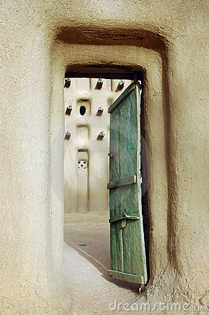 Vertical image of a door into a Dogon mud mosque