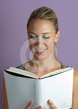 Vertical portrait of a woman reading textbook