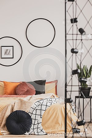 Free Vertical View Of Classy Bedroom Interior With Colorful Bedding And Round Pillows Stock Photos - 140889043