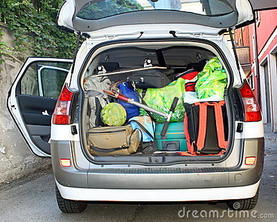 Very car with the trunk full of luggage