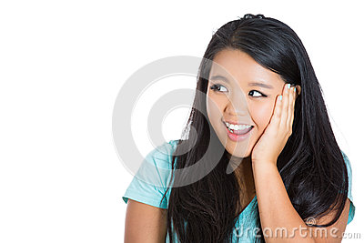 Very excited young woman holding her head in amazement