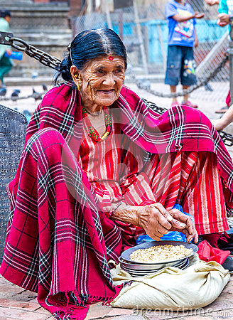 Free Very Old Nepali Woman Selling Grains For Pigeons At The Temple Stock Images - 98926844