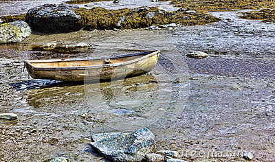 Very old skiff on shore