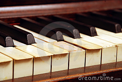Very old wooden piano with ivory keys broken