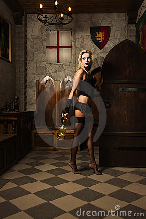Very Pretty Woman Vamp With Lantern Royalty Free Stock Photo - Image: 20107165