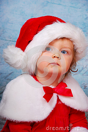 Very serious baby in santa hat