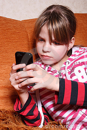 A very serious girl playing games on phone