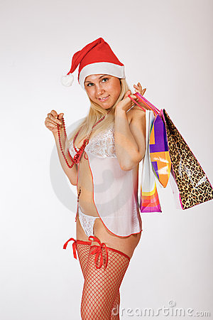 Very sexy Mrs. Santa Claus girl holding gifts