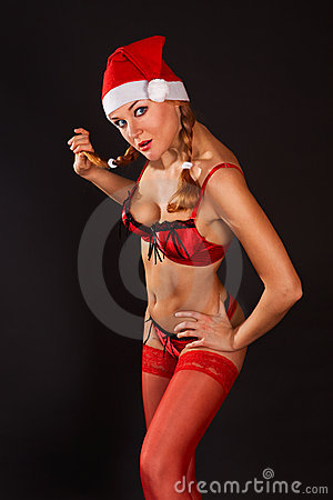 Very sexy Mrs. Santa Claus girl in red underwear