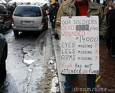 Veteran soldier protesting with sign